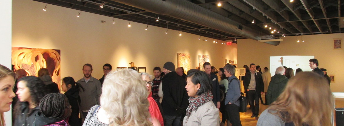An image of the Inc's gallery space during an exhibition opening. The gallery is filled with visitors and artists who appear to be socializing and looking at the artworks on display.